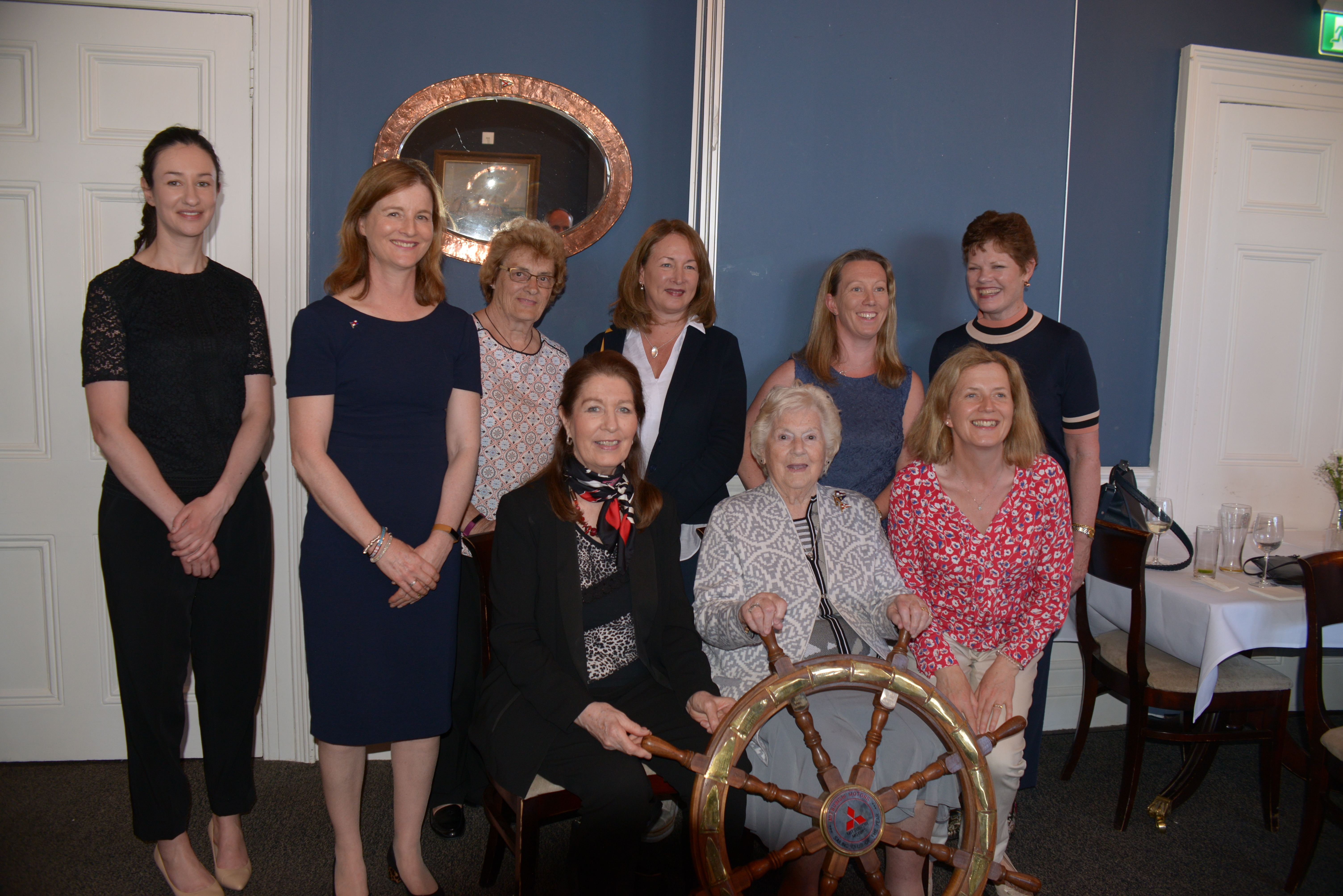 Ladies at the Helm with Mitsubishi ISCY Trophy_ LtoR_ Roseita Burke, Susan Spain, Sandra Moore, Helen Cooney, Fiona Staunton, Kerry Cullen. Front Georgina C, Carmel W & Michelle H
