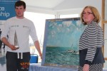 Finn receiving his prize from Joan Collins, Commodore, Baltimore SC